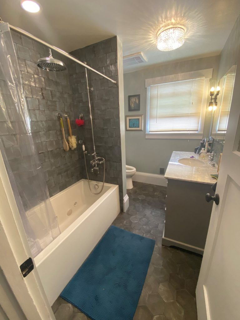 Installing a narrow tub and vanity improved the space in this bathroom.